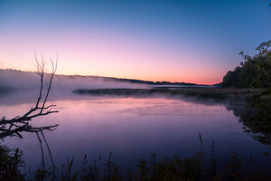 Magical sunrise over lake. Misty morning, rural landscape, wilderness, mystical feeling