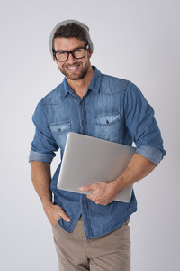 Male hipster with contemporary laptop
