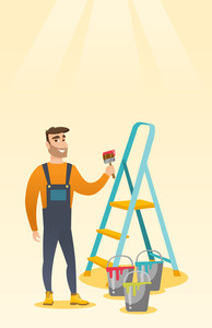 Male house painter holding a paintbrush. House painter with paintbrush in hand standing near step-ladder and paint cans. Concept of house renovation. Vector flat design illustration. Vertical layout.
