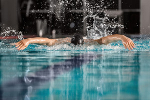 Male swimmer swimming the butterfly stroke in a pool