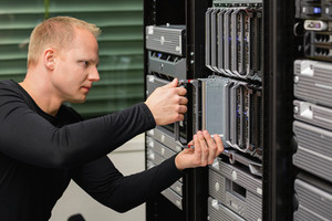 Male Technical Consultant Replacing Blade Server In SAN At Datacenter