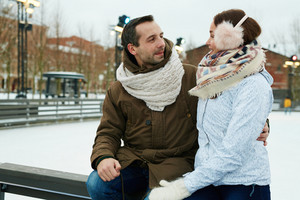 Man and woman in winterwear talking outdoors