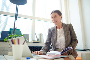 Mature businesswoman networking in office