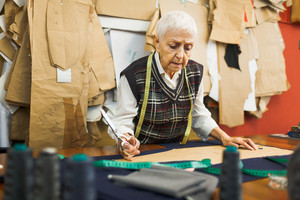 Mature tailor working in her own studio