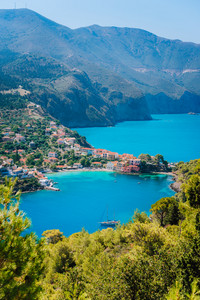 Mediterranean seashore in Greece. Beautiful turquoise colored Assos bay water surrounded by pine and cypress trees. Amazing nature, must see places