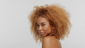 mixed race black blonde model with curly hair on white afro blonde hair