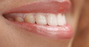 mixed race black woan's mouth closeup smiling side view