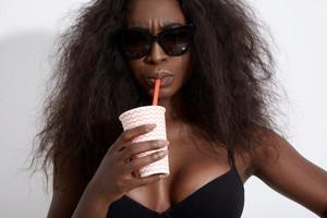 mixed race black woman with huge big hair and ideal body wears bikini