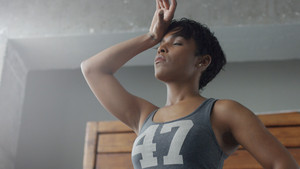 mixed rae african american woman has a rest during her workout breathing deep Body parts
