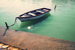 Morning on the lake. Boat near pier