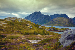 Mountain landscape. Rocky shore of mountain lake in rainy autumn morning. Beautiful nature Norway.