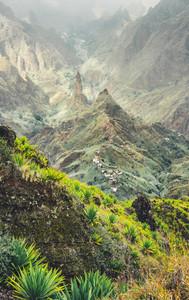Mountain peaks of Xo-Xo valley in sun light. Local village in the valley. Many agava plants grow on the steep stony slopes. Santa Antao island, Cape Verde