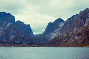 Mountains above fjord landscape, Reine, Norway