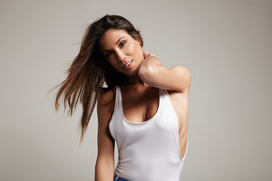 moving spanish woman with shaked hair in white top