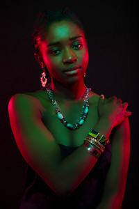 Multi color portrait of confident african woman wearing jewelry