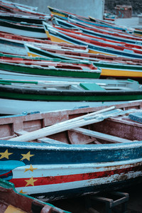 Multicolored local fishing boats waiting on the coast of good weather. Ponta do Sol Santo Antao Cape Verde