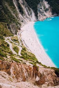 Myrtos Beach. Tourists sunbathing and swiming on sunny day, Kefalonia, Greece