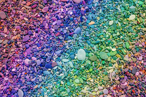 Natural vintage colorful pebbles background. Gradient color