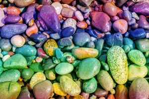 Natural vintage colorful pebbles background. Gradient color