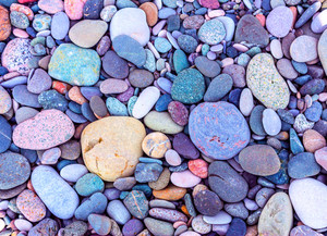 Natural vintage colorful pebbles background.