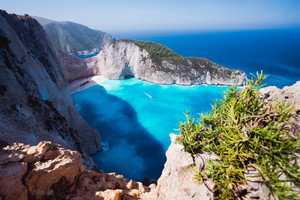 Navagio beach or Shipwreck bay. Turquoise water and pebble white beach in morning light. Famous landmark location on Zakynthos island, Greece