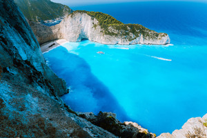 Navagio beach or Shipwreck bay with turquoise water and pebble white beach. Famous landmark location. Landscape of Zakynthos island, Greece