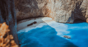 Navagio beach panoramic shot in moody vintage waved bay water and abandoned shipwreck on shore. Zakynthos Island, Greece