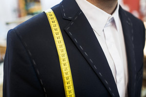 New jacket and measuring tape on businessman
