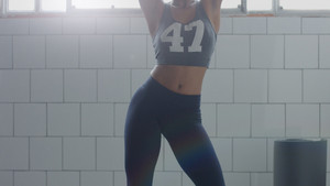 no recognizeble woman dancing in sunny loft during weight fitness workout slowmotion from 60 fps