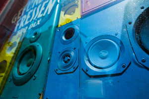 Old colorful sound speakers boxes in shop window vitrine. Concept of retro vintage interior decoration