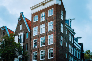 Old Tilted Houses in Amsterdam. Unique dutch architecture