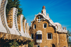 One of a colorful mosaic building in Park Guell in evening warm Sun light, Barcelona, Spain