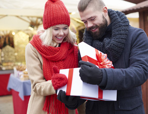 Opening big gift on christmas market