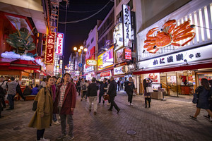osaka japan - november6,2018 : large number of tourist attraction to dotonbori square place of glico brand banner sign ,dotonbori canal is one of most popular shopping destination in osaka