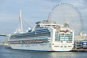 osaka japan - november8,2018 : princes cruises luxuri cruising ship approach on port of tempozan osaka