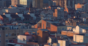 pan movement acrossphoto oa city buildings of Barcelona at sunrise