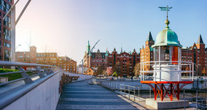 Panorama of Hafencity with old beacon lighthouse and red brick building in background, Speicherstadt in Hamburg