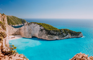 Panoramic view of Navagio beach, Zakynthos island, Greece. Wide Shipwreck bay with turquoise water and white sand beach. Famous landmark location in the World