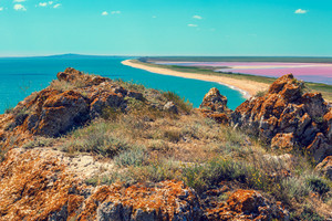 Panoramic view of Pink lake and sea. View from mountain, top view
