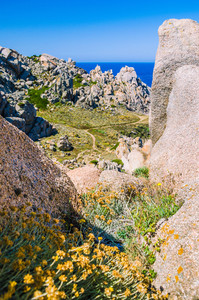 Path betweeen bizarre granite rock formations in Capo Testa, Sardinia, Italy
