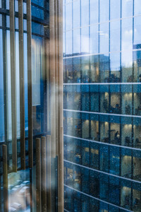 Pattern of glassy modern office building in rainy weather