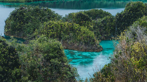 Peanemo Islands with blue lagoon between. Untouched nature. Raja Ampat, West Papua, Indonesia