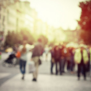 People in street abstract blur background. Sunny