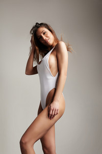 perfect fit spanish woman in swimsuit. straight hair