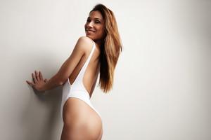 perfect fit spanish woman in swimusit. long straight hair