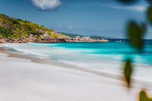 Petite Anse, La Digue in Seychelles. Tropcial, white sand paradise beach with turquise colored water on bright sanny day