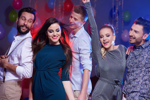 Photo of a happy and young dancing people