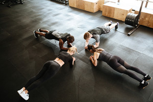Picture of fitness group of people make sports exercise indoors.