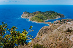 Picturesque view of sunny Assos village and blue sea bay. Kefalonia island, Greece