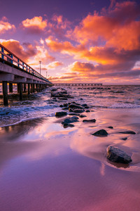 Pier and sea at pink sunset